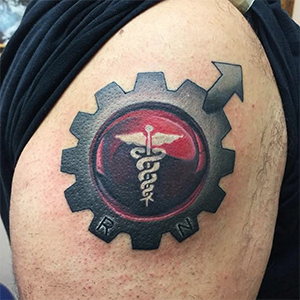 MJ Bonanno - Medical Symbol Gear Tattoo